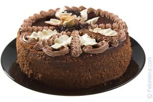 Сонник торт разрезанный пополам с шоколадными цветами